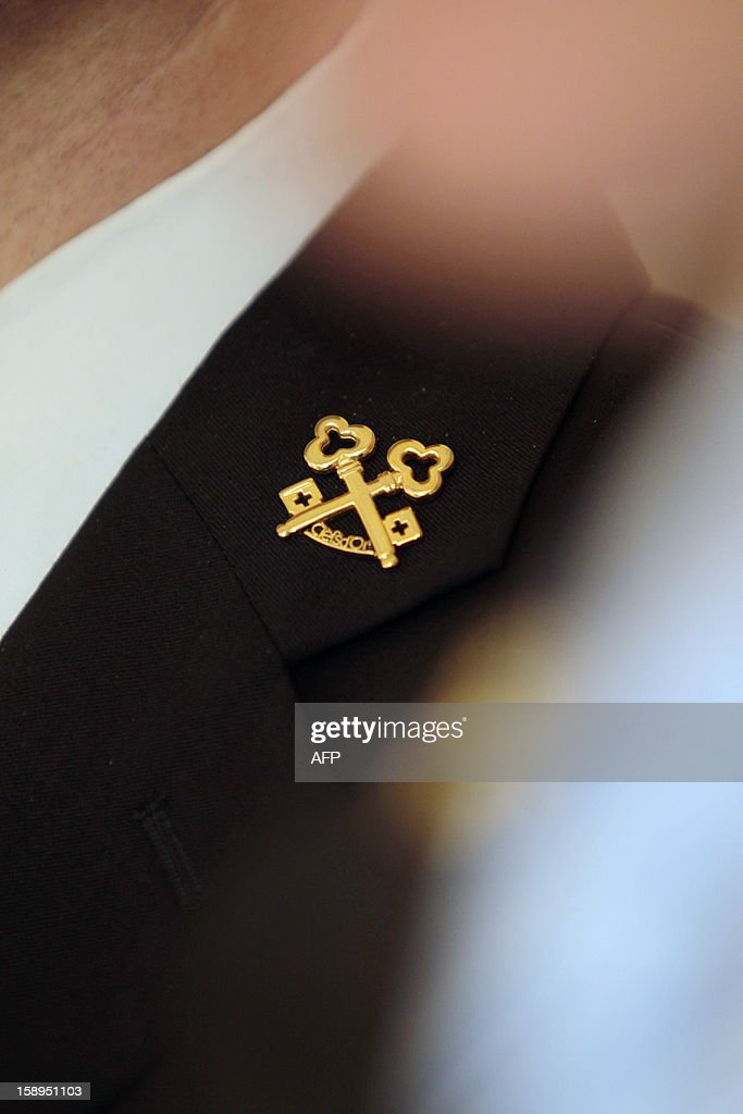 A chief concierge of a luxury hotel wears gold keys at his buttonhole, the emblem of the Union Internationale des Concierges d'Hotels, on January 4, 2013 in Cannes, southeastern France.