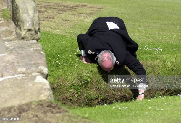Chief Constable of Fife constabulary John Hamilton pauses from talks with Scotland's Deputy First Minister Jim Wallace to retrieve his hat from the...
