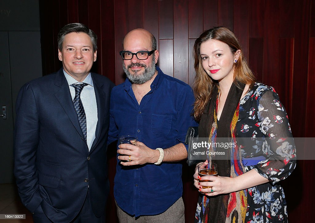 Chief Content Officer, Netflix, Inc. Ted Sarandos with actors <a gi-track='captionPersonalityLinkClicked' href=/galleries/search?phrase=David+Cross+-+Amerikanischer+Schauspieler&family=editorial&specificpeople=214785 ng-click='$event.stopPropagation()'>David Cross</a> and <a gi-track='captionPersonalityLinkClicked' href=/galleries/search?phrase=Amber+Tamblyn&family=editorial&specificpeople=202906 ng-click='$event.stopPropagation()'>Amber Tamblyn</a> at Netflix's 'House Of Cards' New York Premiere After Party at Alice Tully Hall on January 30, 2013 in New York City.