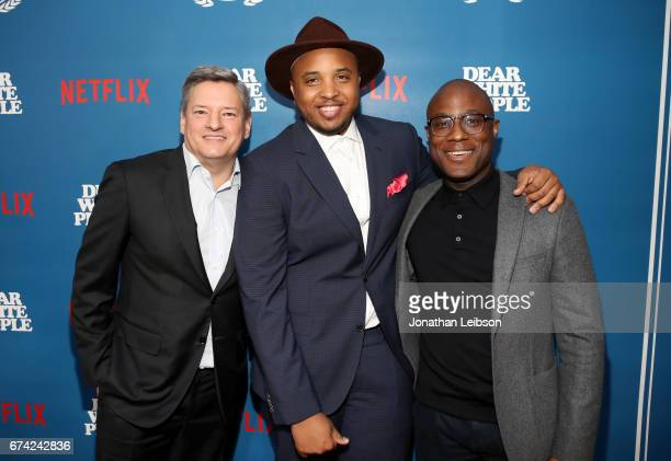 Chief content officer Netflix Ted Sarandos writer/producer Justin Simien and director Barry Jenkins attend Netflix Dear White People S1 premiere LA...