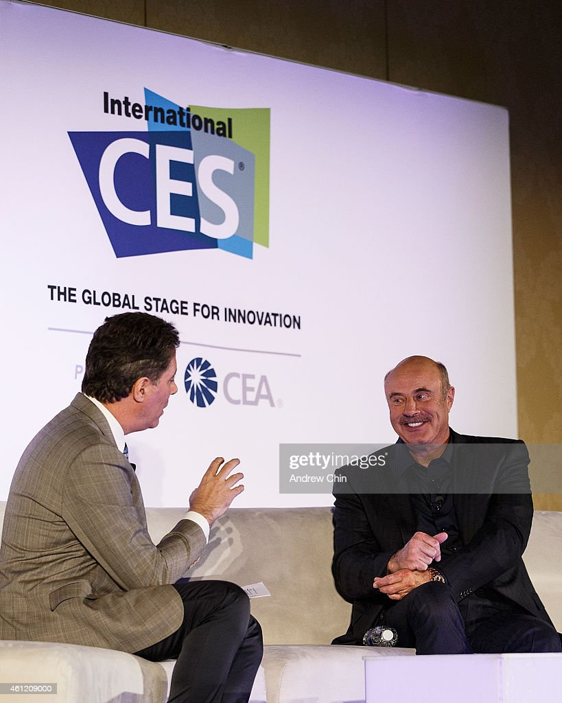 Chief Correspondent for Inside Edition Jim Moret interviews television personality Dr. <a gi-track='captionPersonalityLinkClicked' href=/galleries/search?phrase=Phil+McGraw&family=editorial&specificpeople=234933 ng-click='$event.stopPropagation()'>Phil McGraw</a> during the 2015 International CES held at Sands Convention Center on January 8, 2015 in Las Vegas, Nevada.