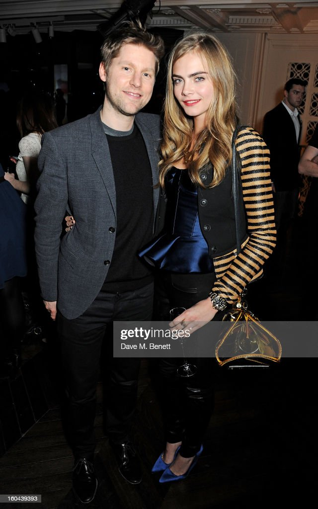 Chief Creative Officer of Burberry Christopher Bailey (L) and Cara Delevingne, wearing Burberry, attend the Burberry Live at 121 Regent Street event on January 31, 2013 in London, England.