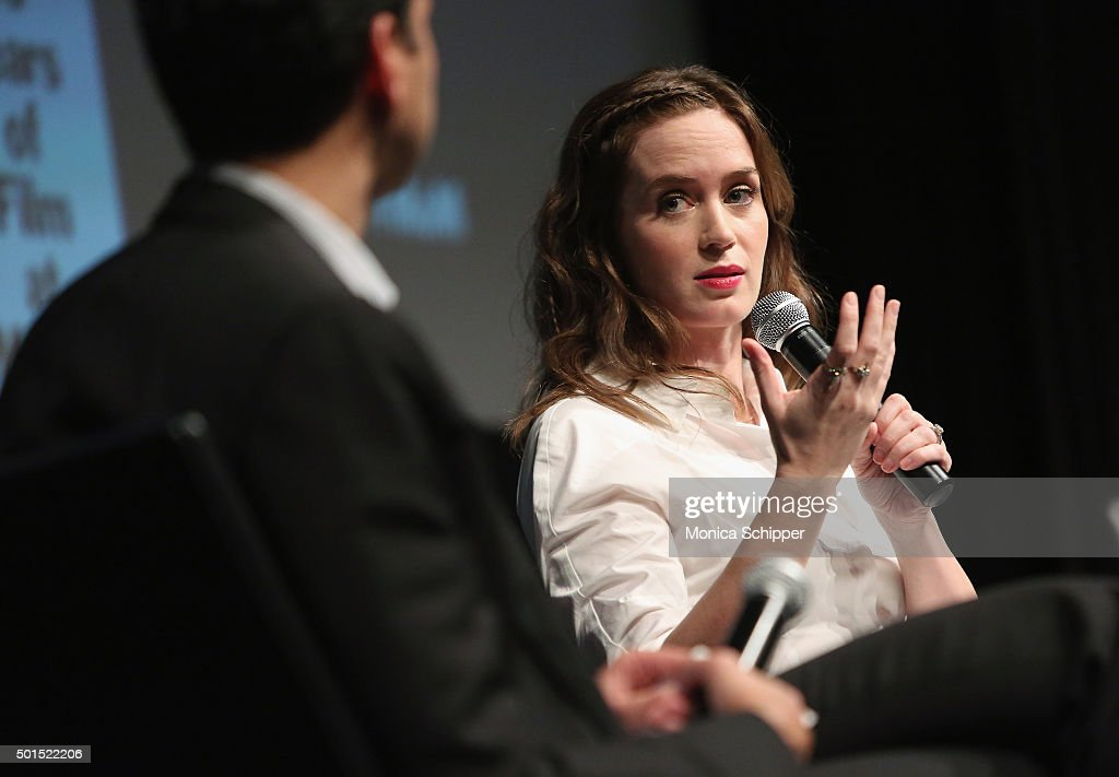 Chief Curator of Film at MoMa Film Rajendra Roy (L) and actress Emily Blunt speak at the panel discussion following MoMA Film's THE CONTENDERS Screening Of SICARIO at MOMA on December 15, 2015 in New York City.
