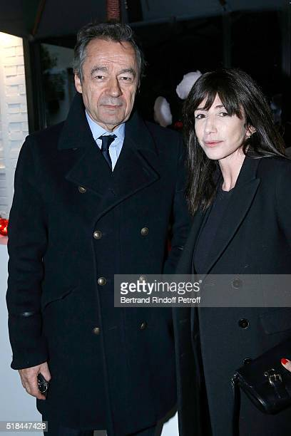 Chief Editor of Vanity Fair France Michel Denisot and Albane Cleret attend the 'Guy Bourdin Portraits' Exhibition Opening and Cocktail at Studio des...