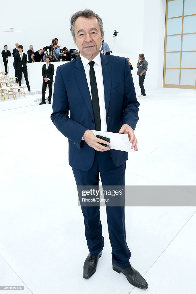 Chief Editor of Vanity Fair France, Michel Denisot attends the Chanel show as part of Paris Fashion Week - Haute Couture Fall/Winter 2014-2015. Held at Grand Palais on July 8, 2014 in Paris, France.