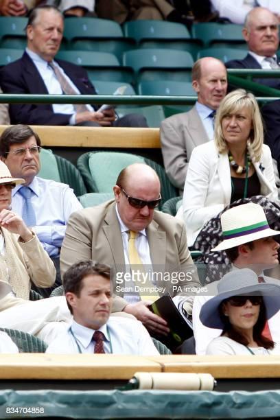 FA Chief Executive Brian Barwick watches the match between USA's Serena Williams and China's Jie Zheng during the Wimbledon Championships 2008 at the...