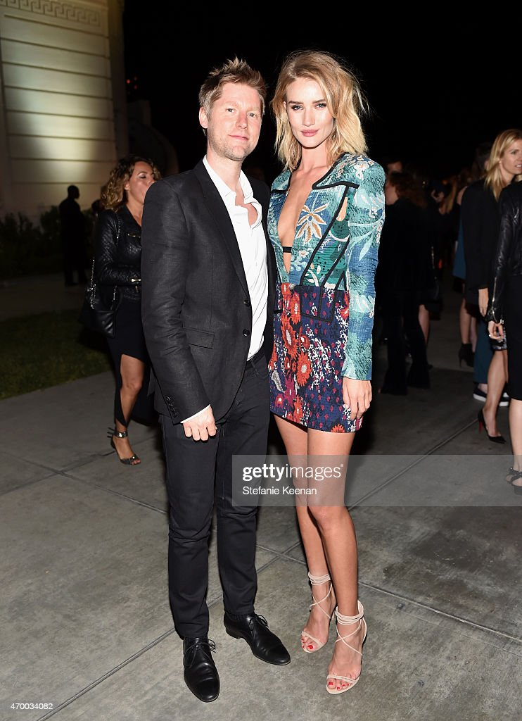 Chief executive chief creative officer at Burberry Christopher Bailey and model Rosie HuntingtonWhiteley attend the Burberry 'London in Los Angeles'...
