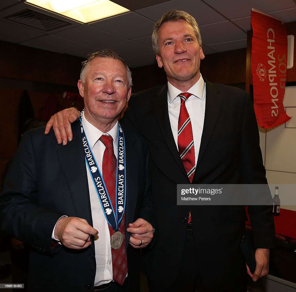Chief Executive <a gi-track='captionPersonalityLinkClicked' href=/galleries/search?phrase=David+Gill+-+Soccer+Executive&family=editorial&specificpeople=212730 ng-click='$event.stopPropagation()'>David Gill</a> and Manager Sir <a gi-track='captionPersonalityLinkClicked' href=/galleries/search?phrase=Alex+Ferguson&family=editorial&specificpeople=203067 ng-click='$event.stopPropagation()'>Alex Ferguson</a> of Manchester United celebrate in the dressing room after the Barclays Premier League match between Manchester United and Swansea City at Old Trafford on May 12, 2013 in Manchester, England.
