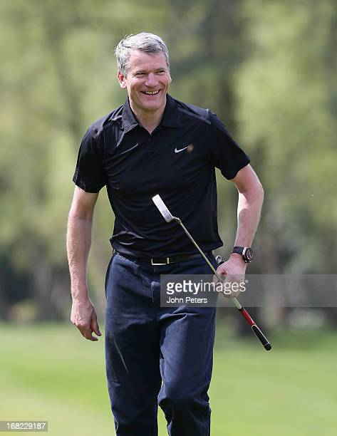 Chief Executive David Gill of Manchester United takes part in a Players v Coaching Staff golf match at Dunham Massey Golf Club on May 7 2013 in...