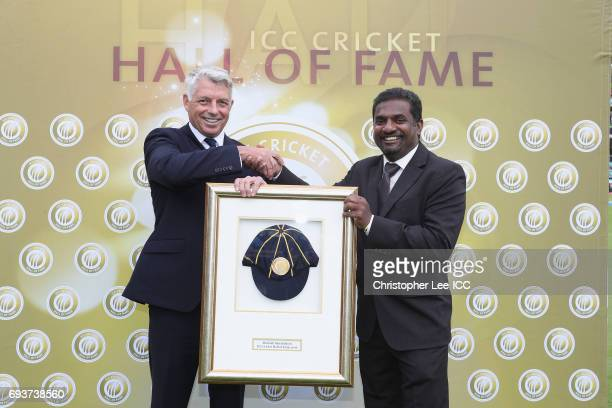 Chief Executive David Richardson presents Muttiah Muralidaran of Sri Lanka with his Hall of Fame Cap during the ICC Champions Trophy Group B match...