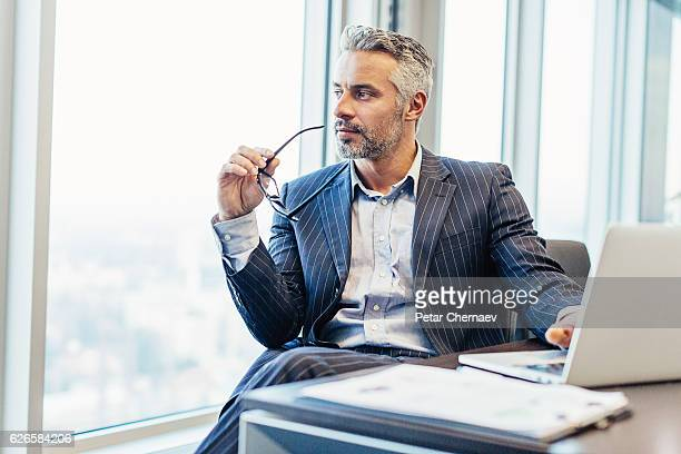 Chief executive looking through the window
