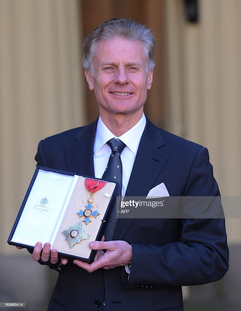 Chief Executive, Lord Deighton poses for photographs after he was made a knight commander at Buckingham Palace in London on March 12, 2013. AFP PHOTO/POOL/Stefan Rousseau
