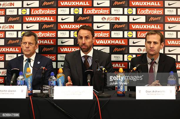 Chief Executive Martin Glenn and FA Technical Director Dan Ashworth look on as Gareth Southgate speaks at a press conference as he is unveiled as the...