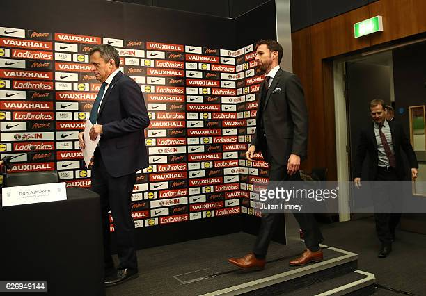 Chief Executive Martin Glenn and FA Technical Director Dan Ashworth walk into the a press conference with Gareth Southgate as he is unveiled as the...