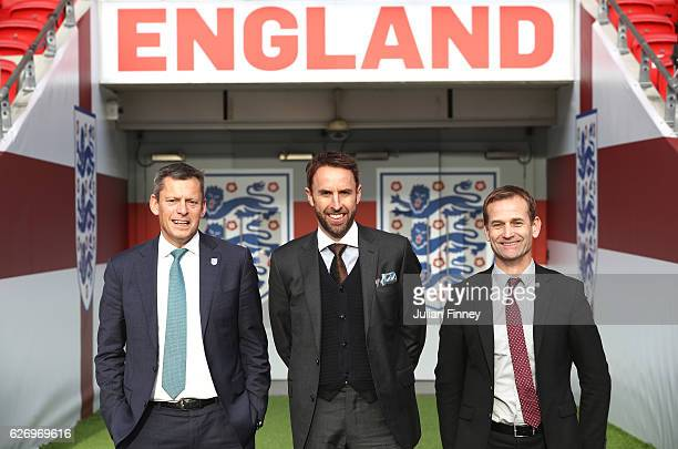 Chief Executive Martin Glenn and FA Technical Director Dan Ashworth stand alongside Gareth Southgate as he is unveiled as the new England manager at...