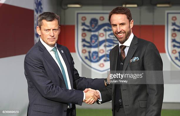 Chief Executive Martin Glenn shakes hands with Gareth Southgate in front of the tunnel as he is unveiled as the new England manager at Wembley...