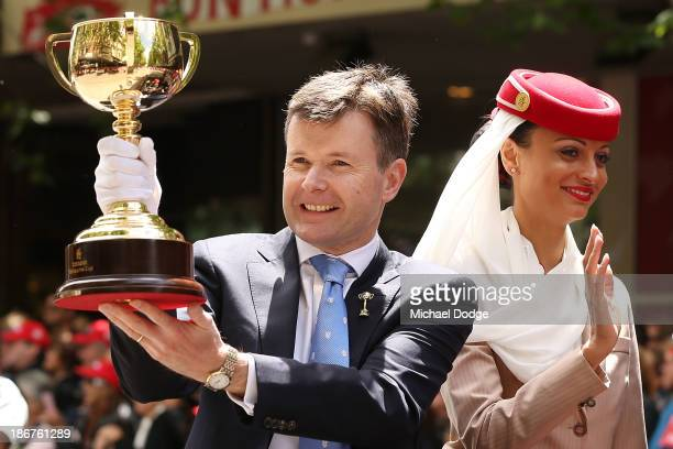 Chief executive Michael Burn holds up the Cup during the 2013 Melbourne Cup Parade on November 4 2013 in Melbourne Australia