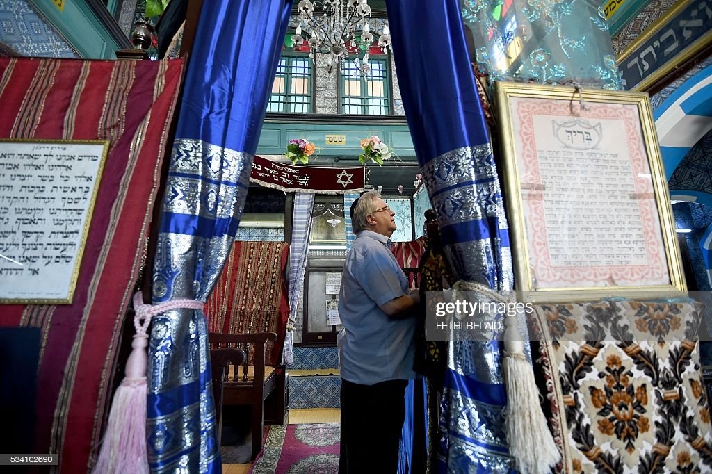 Chief executive of Liberal Judaism in the United Kingdon Rabbi Danny Rich prays at the Ghriba synagogue in the Tunisian resort island of Djerba during the annual Jewish pilgrimage on May 25, 2016. Pilgrims arrived at Tunisia's Ghriba synagogue, the oldest in Africa, expressing hope that this year would mark a turning point for the ritual despite a rise in Islamist unrest since the 2011 revolution. Djerba is home to one of the last Jewish communities in the Arab world. / AFP / FETHI