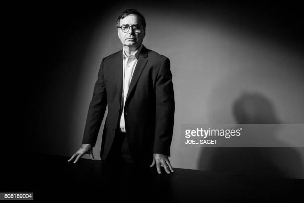 Chief Executive of Magnum Photos Britain's David Kogan poses during a photo session in Paris on July 3 2017 / AFP PHOTO / JOEL SAGET