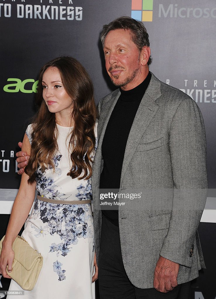 Chief executive of Oracle Corporation Larry Ellison (R) and Nikita Kahn arrive at the Los Angeles premiere of 'Star Trek: Into Darkness' at Dolby Theatre on May 14, 2013 in Hollywood, California.