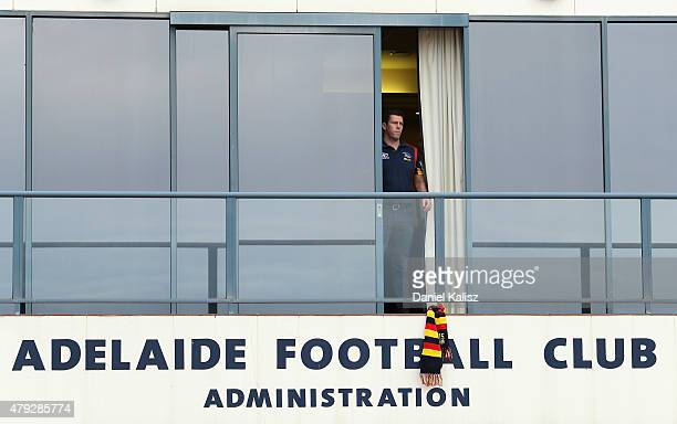 Chief Executive of the Adelaide Crows Andrew Fagan hangs a scarf out as a sign of remembrance at AAMI Stadium on July 3 2015 in Adelaide Australia...