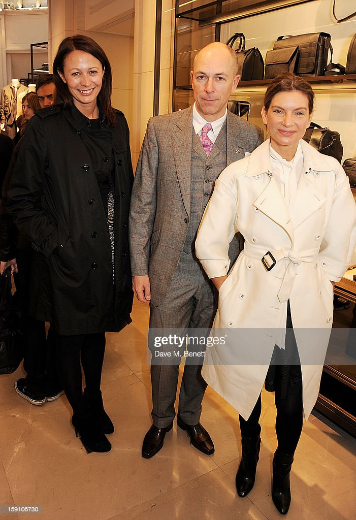 Chief Executive of the British Fashion Council Caroline Rush, editor of GQ <a gi-track='captionPersonalityLinkClicked' href=/galleries/search?phrase=Dylan+Jones&family=editorial&specificpeople=712578 ng-click='$event.stopPropagation()'>Dylan Jones</a> and founder of Net-A-Porter <a gi-track='captionPersonalityLinkClicked' href=/galleries/search?phrase=Natalie+Massenet&family=editorial&specificpeople=2118990 ng-click='$event.stopPropagation()'>Natalie Massenet</a> attend the Burberry Knightsbridge Menswear store to celebrate London Collections: Men AW13 on January 8, 2013 in London, England.