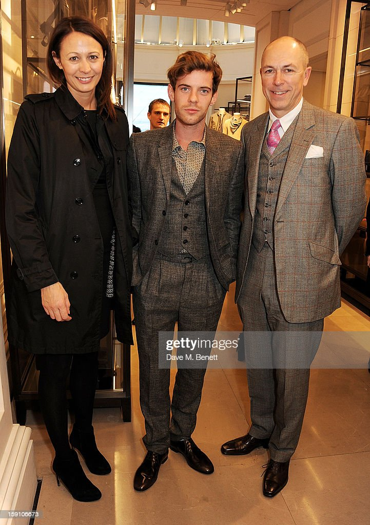 Chief Executive of the British Fashion Council Caroline Rush, host <a gi-track='captionPersonalityLinkClicked' href=/galleries/search?phrase=Harry+Treadaway&family=editorial&specificpeople=737103 ng-click='$event.stopPropagation()'>Harry Treadaway</a>, wearing Burberry, and editor of GQ <a gi-track='captionPersonalityLinkClicked' href=/galleries/search?phrase=Dylan+Jones&family=editorial&specificpeople=712578 ng-click='$event.stopPropagation()'>Dylan Jones</a> attend the Burberry Knightsbridge Menswear store to celebrate London Collections: Men AW13 on January 8, 2013 in London, England.
