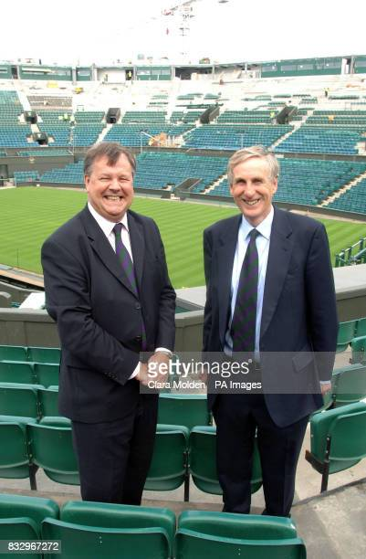 Chief Executive of the club Ian Ritchie and club Chairman Tim Phillips stand in the stands of the Centre Court at The All England Lawn Tennis Club in...