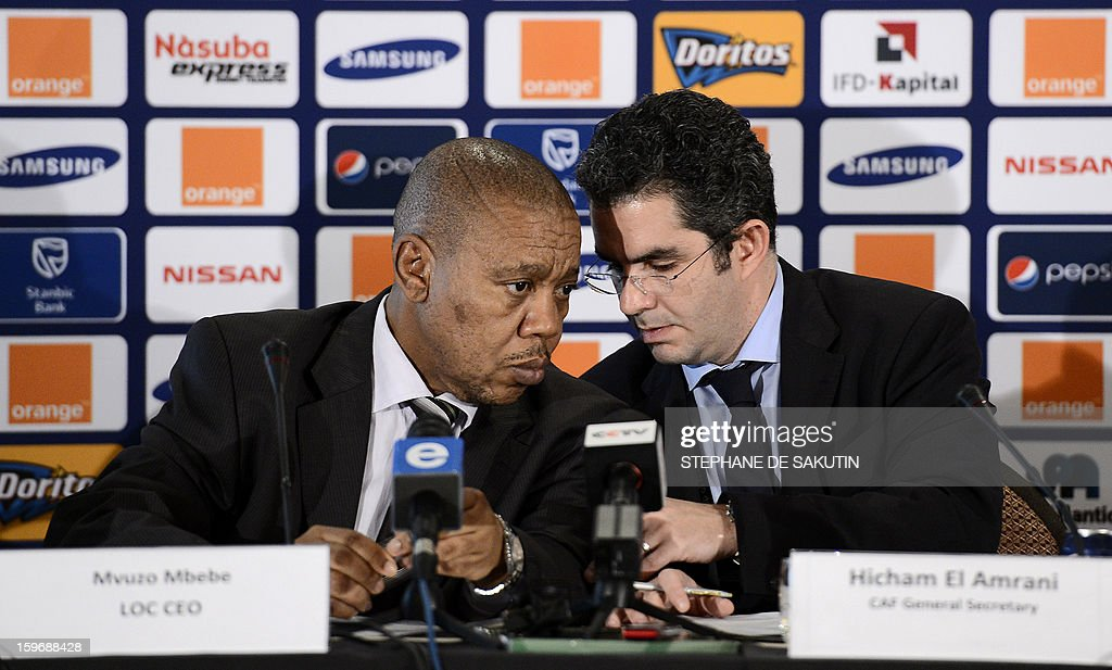 Chief Executive of the Local Organising Committee of the 2013 Africa Cup of Nations (AFCON), Mvuzo Mbebe (L) talks to Confederation of African Football (CAF) Secretary General, Hicham El Amrani during a press conference on January 18, 2013 in Johannesburg on the eve of the start of the 2013 Africa Cup of Nations hosted by South Africa from January 19 to February 10.
