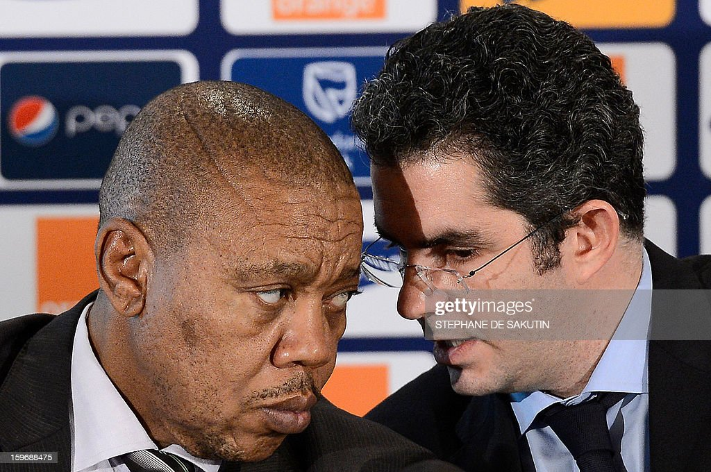 Chief Executive of the Local Organising Committee of the 2013 Africa Cup of Nations (AFCON), Mvuzo Mbebe (L) talks to Confederation of African Football (CAF) Secretary General, Hicham El Amrani during a press conference on January 18, 2013 in Johannesburg on the eve of the start of the 2013 Africa Cup of Nations hosted by South Africa from January 19 to February 10. AFP PHOTO / STEPHANE DE SAKUTIN