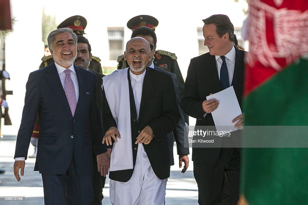 Chief Executive Officer <a gi-track='captionPersonalityLinkClicked' href=/galleries/search?phrase=Abdullah+Abdullah&family=editorial&specificpeople=695346 ng-click='$event.stopPropagation()'>Abdullah Abdullah</a>, President Ashraf Ghani and Britain's Prime Minister David Cameron arrive for press conference on October 3, 2014 in Kabul, Afghanistan. David Cameron is the first world leader to meet Afghanistan's new President Ashraf Ghani and his defeated opponent in the presidential race <a gi-track='captionPersonalityLinkClicked' href=/galleries/search?phrase=Abdullah+Abdullah&family=editorial&specificpeople=695346 ng-click='$event.stopPropagation()'>Abdullah Abdullah</a> since the new government was formed. Mr Camerons visit was unannounced to Kabul and comes after a visit late last night to RAF Akrotiri in Cyprus from where RAF Tornados are launching air strikes against Islamic State militants in Iraq.