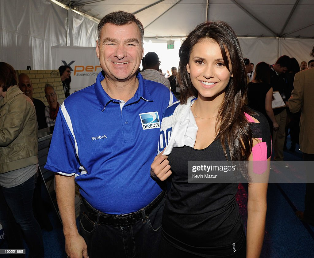 Chief Executive Officer and President of DIRECTV Michael White and actress Nina Dobrev attend DIRECTV'S 7th annual celebrity Beach Bowl at DTV SuperFan Stadium at Mardi Gras World on February 2, 2013 in New Orleans, Louisiana.