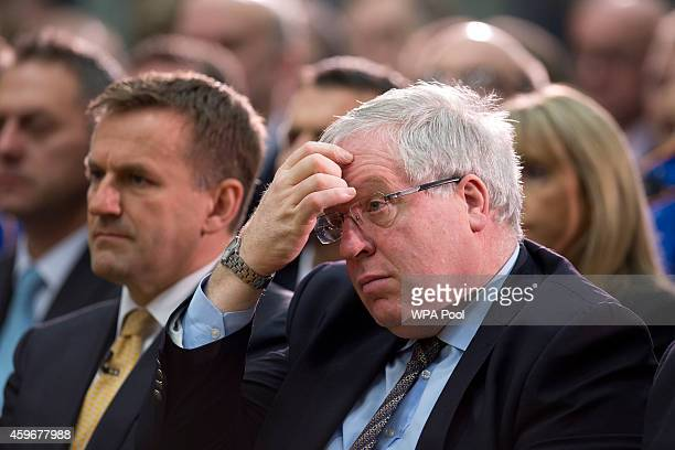 Chief Executive Officer Graeme Macdonald and British Secretary of State for Transport Patrick McLoughlin listen as British Prime Minister David...