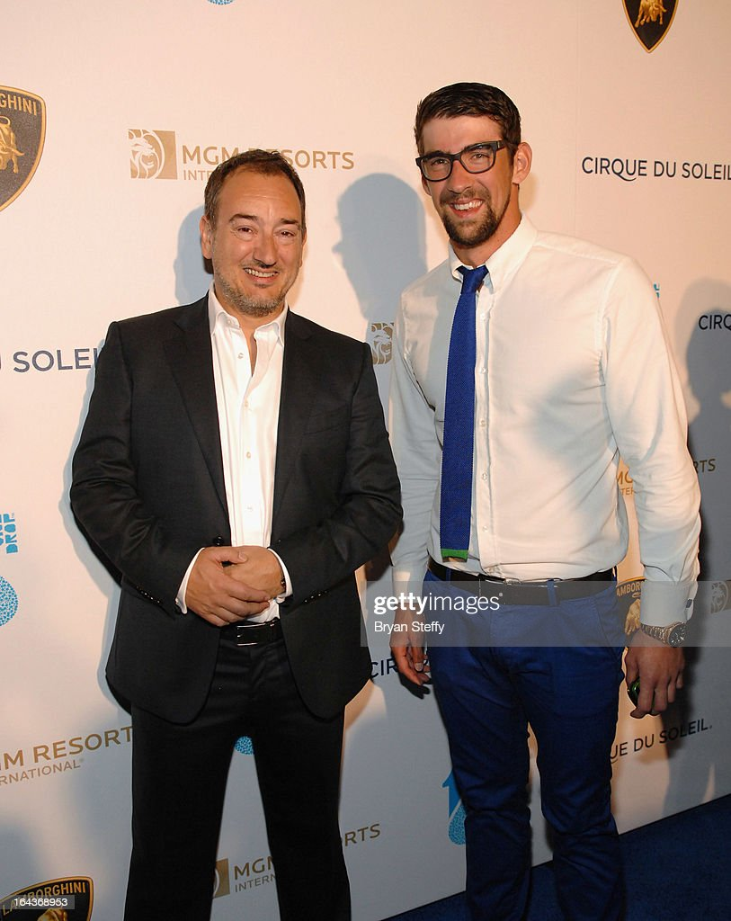 Chief Executive Officer of Automobili Lamborghini America Michael Lock (L) and swimmer <a gi-track='captionPersonalityLinkClicked' href=/galleries/search?phrase=Michael+Phelps&family=editorial&specificpeople=162698 ng-click='$event.stopPropagation()'>Michael Phelps</a> arrive at Cirque du Soleil's 'One Night for ONE DROP' at Hyde Bellagio at the Bellagio on March 22, 2013 in Las Vegas, Nevada.