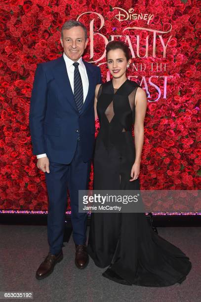 Chief Executive Officer of Disney Bob Iger and actress Emma Watson pose backstage at the New York special screening of Disney's liveaction adaptation...