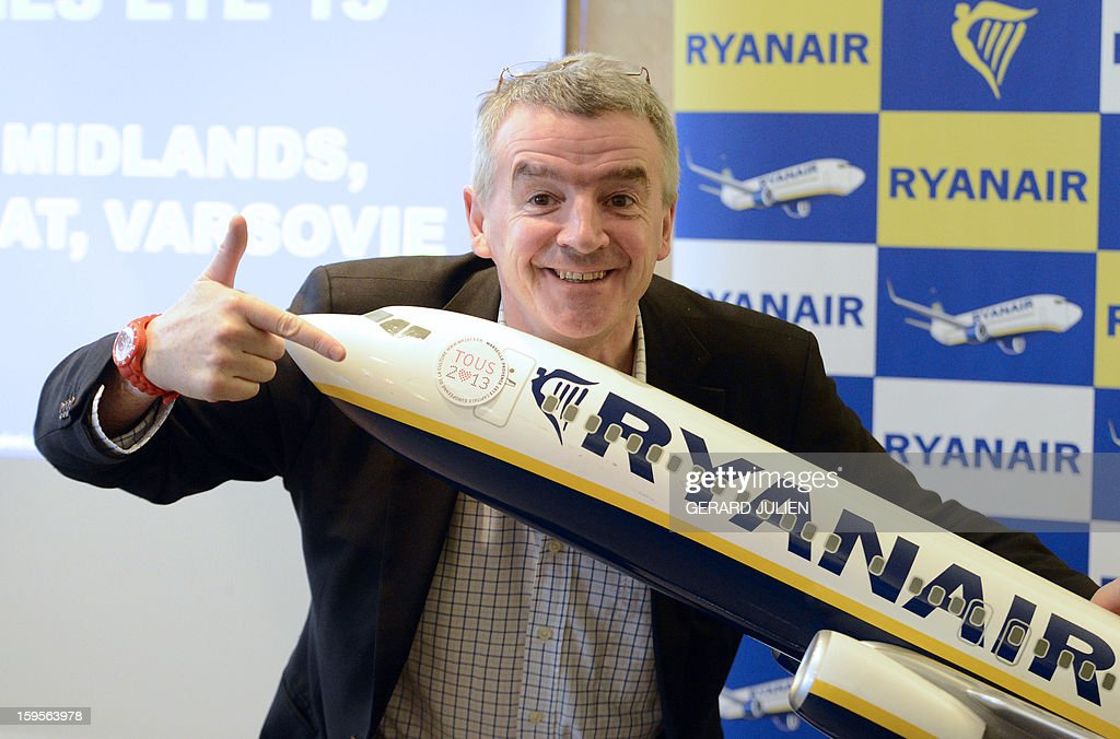 Chief executive officer (CEO) of Irish airline Ryanair Michael O'Leary leans on a model Ryanair airplane decotrated with Marseille's 2013 city of culture logo on January 16, 2013 during a press conference in Vitrolles, near Marseille's airport, southern France. Low-cost Irish airline Ryanair is to open two new bases this spring in Morocco, its first outside Europe, company chief Michael O'Leary told AFP on Wednesday. AFP PHOTO/GERARD JULIEN