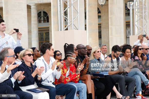 Chief Executive Officer of Louis Vuitton Michael Burke his wife Brigitte Burke Jeremie Laheurte Tyga Naomi Campbell and Luka Sabbat attend the Louis...