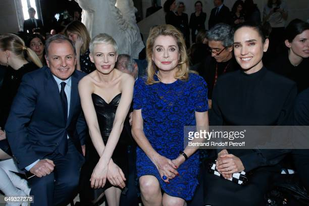 Chief Executive Officer of Louis Vuitton Michael Burke Michelle Williams Catherine Deneuve and Jennifer Connelly attend the Louis Vuitton show as...