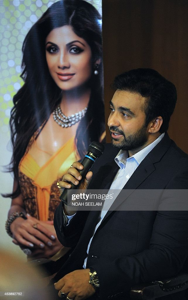Chief Executive Officer of Satyug Gold, and husband of Indian film actress Shilpa Shetty, Raj Kundra speaks at the launch of the 'Satyug Mera Gold Plan' at a press conference in Hyderabad on August 21, 2014. According to the plan, customers in India can buy gold from 50 rupees (80 US cents) a day in a systematic manner as Satyug Gold has signed long term sourcing contracts with mines in South Africa, Ghana and Peru for the consistent supply of gold directly from the mines through their own refinery in India. AFP PHOTO / Noah SEELAM