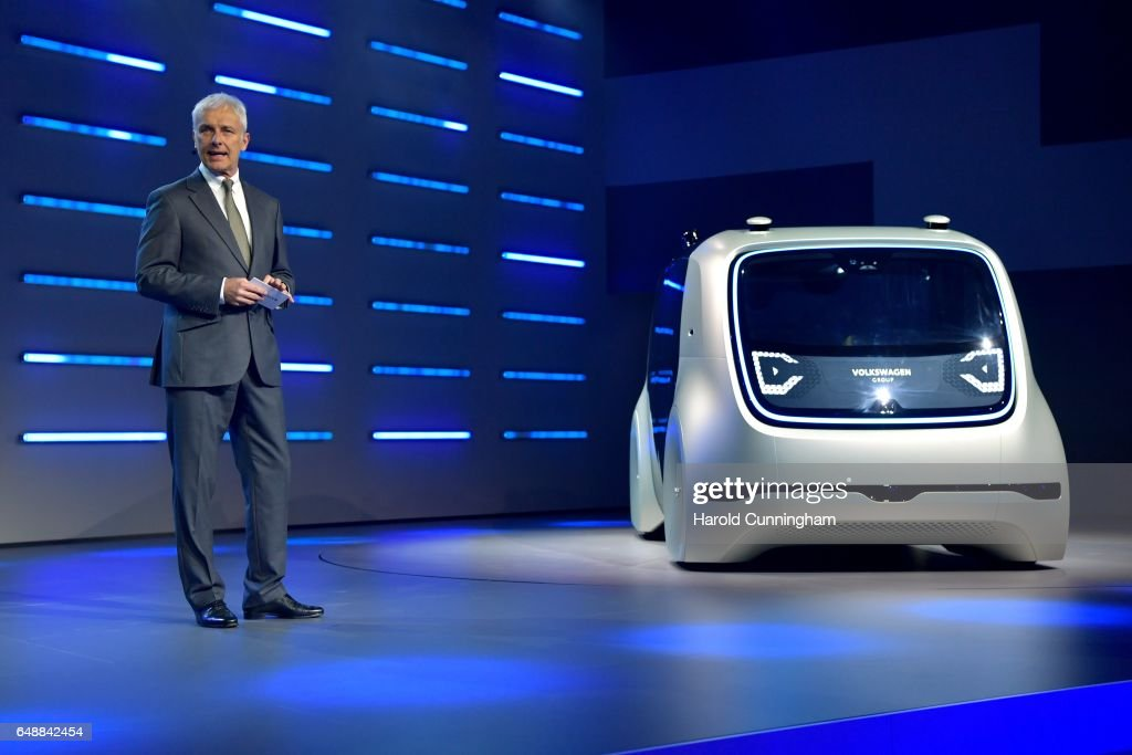Chief Executive Officer of Volkswagen AG (VW) Matthias Mueller presents a Volkswagen AG (VW) 'Cedric' self-driving automobile during the Volkswagen Group Shaping The Future / Create Innovation event ahead of the 87th Geneva International Motor Show on March 6, 2017 in Geneva, Switzerland. The International Motor Show showcase novelties of the car industry.