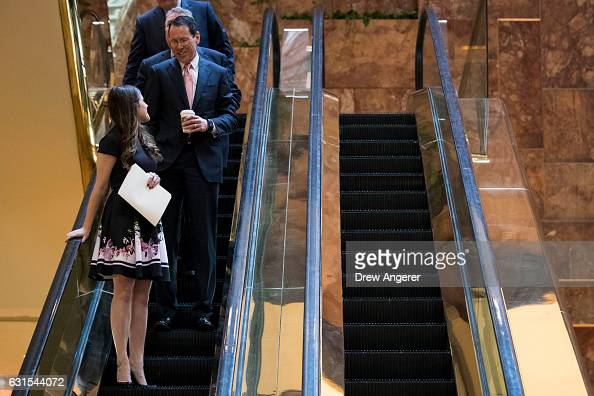Chief Executive Officer Randall Stephenson takes an escaltor down to the lobby at Trump Tower January 12 2017 in New York City Trump and his...