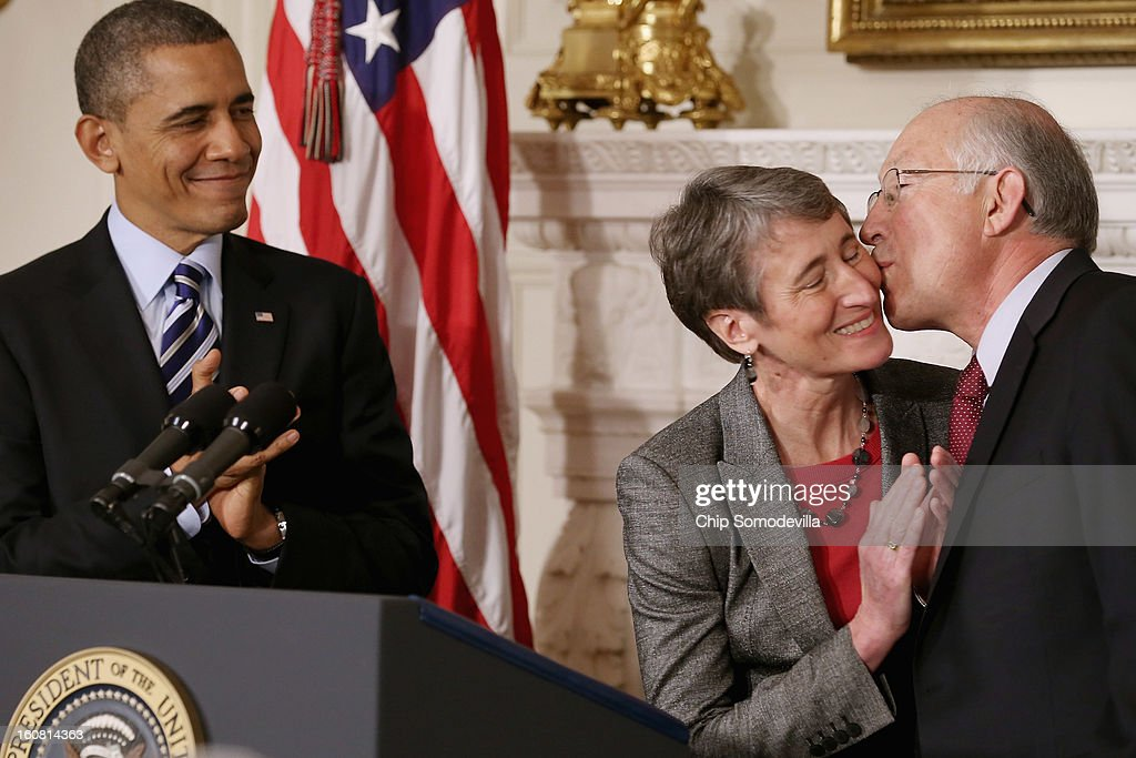 Chief Executive Officer Sally Jewell (C) is congratulated by outgoing Interior Secrtary <a gi-track='captionPersonalityLinkClicked' href=/galleries/search?phrase=Ken+Salazar&family=editorial&specificpeople=228558 ng-click='$event.stopPropagation()'>Ken Salazar</a> after she was nominated by President <a gi-track='captionPersonalityLinkClicked' href=/galleries/search?phrase=Barack+Obama&family=editorial&specificpeople=203260 ng-click='$event.stopPropagation()'>Barack Obama</a> to be the next Secretary of the Interior in the State Dining Room of the White House February 6, 2013 in Washington, DC. Jewell has been CEO of the huge outdoor retailer REI since 2005.