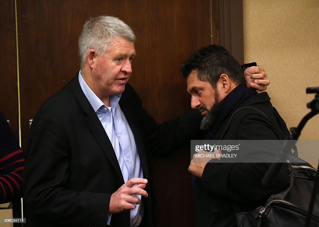Chief Executive Steve Tew (L) speaks to All Black Sonny Bill Williams' manager, Khoder Nasser (R) after it was announced that Sonny Bill Williams has signed a three year deal with the New Zealand Rugby Union and will play for the Auckland Blues next year in Auckland on June 01, 2016. / AFP / MICHAEL