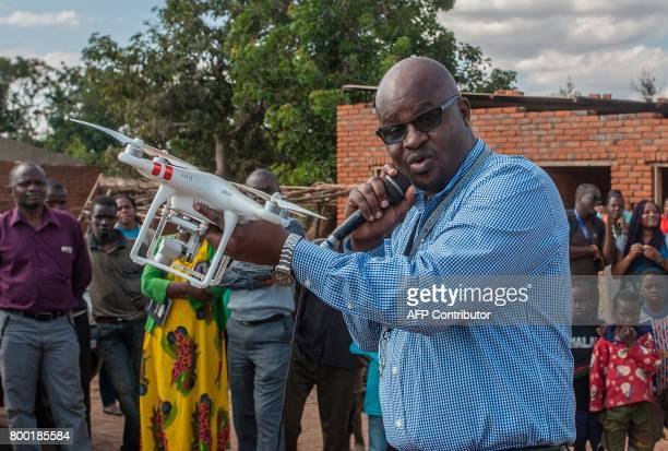 Chief Flight Operations in the Department of Civil Aviation Hastings Jailosi presents a drone to journalists on June 22 in regards to humanitarian...