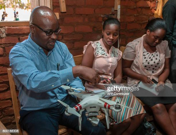 Chief Flight Operations in the Department of Civil Aviation Hastings Jailosi presents a drone to journalists in Kasungu on June 22 during a...