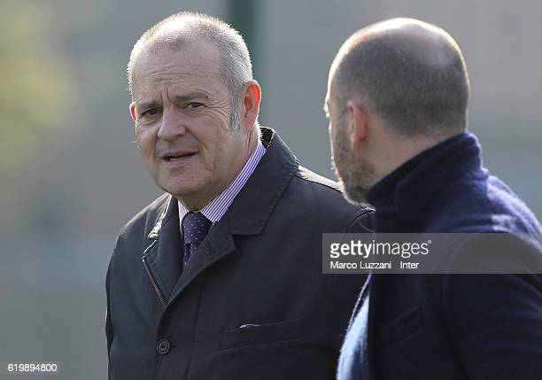 Chief Football Administrator of FC Internazionale Milano Giovanni Gardini speaks to Sportif Director of FC Internazionale Milano Piero Ausilio looks...