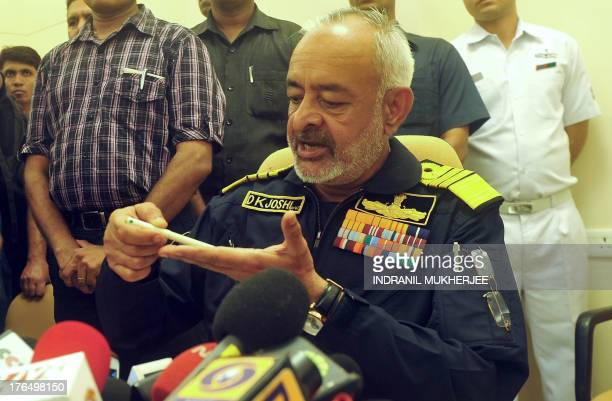 Chief for Indian Naval Staff Admiral DK Joshi briefs journalists following an explosion on board the INS Sindhurakshak submarine at the Naval...