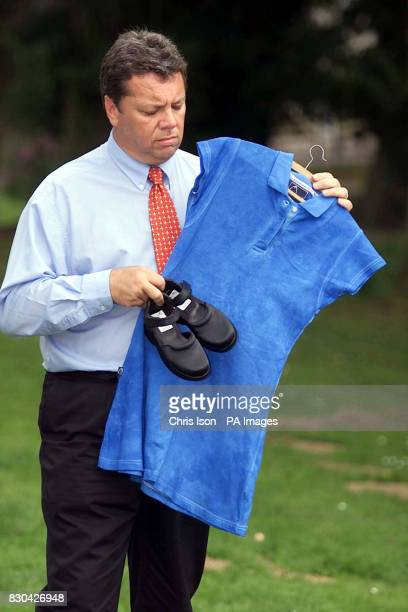 Chief Inspector Mike Alderson holds a Fred Perry style sports dress and a pair of Ladybird shoes like the ones worn by murdered school girl Sarah...