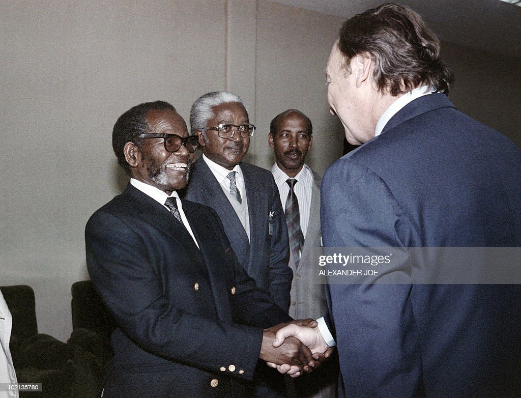 UNHCR chief Jean-Pierre Hockie (R) welcomes South African Oliver Tambo, President of ANC (L) and Sylvestre Nsanzimana of Rwanda (C), on July 22, 1989 at the OAU summit in Addis Ababa.