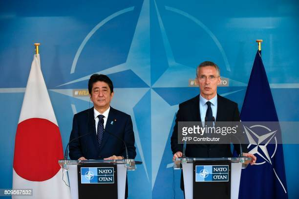 NATO chief Jens Stoltenberg and Japanese Prime Minister Shinzo Abe speak during a press conference at the NATO headquarters in Brussels on July 6...